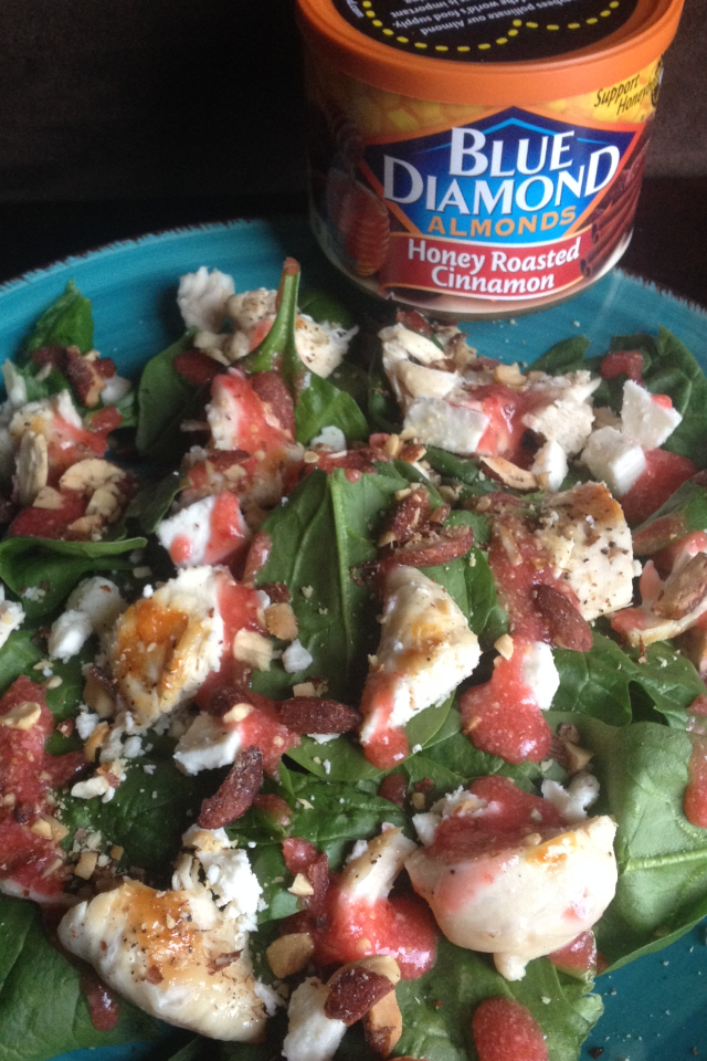 Spinach Salad with chicken, feta, blue diamond honey cinnamon almonds topped with fresh strawberry dressing