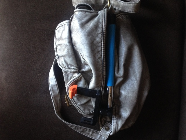 selfie stick in bag